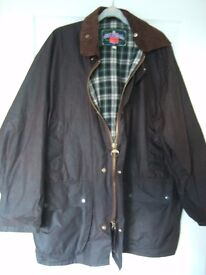 Brown waxed gentleman's raincoat by Miller and Simons