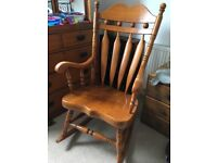 Wooden rocking chair. High back and full arm rests good used condition