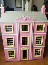 Lovely pink wooden large dolls house