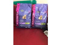 2 bags of puppy dry food called Eukanuba