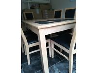 Dining table with slate inserts and 6 faux leather chairs