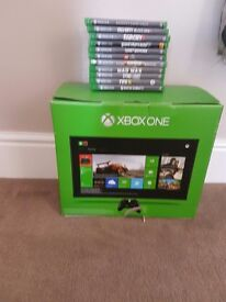 Xbox one boxed with eleven games, controller and leads