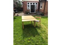 Ikea Bjursta extending table with four chairs