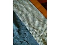 Pair of plain blue curtains with gingham trim