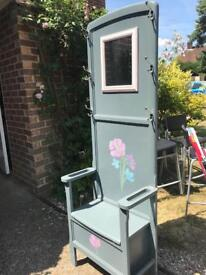 Storage gains painted chair