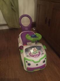 Buzzlightyear lights and sound walker/ride on car