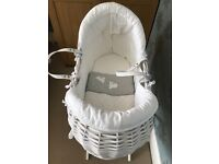 Practically brand new white mamas and papas Moses basket with stand.