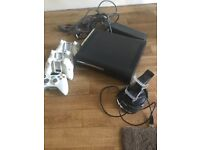 Xbox 360 console, controllers and charging unit