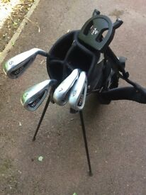 Half set of golf clubs and bag