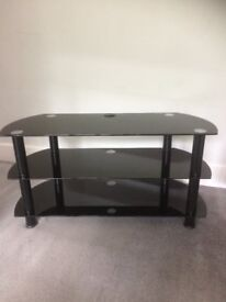 black glass tv stand which would hold a large tv