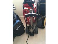 Multiple golf clubs/sets including golf accessories.