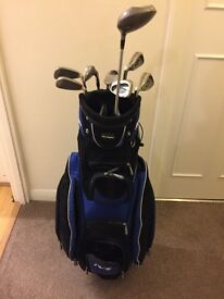 Men's left-handed golf clubs (irons & driver) with bag