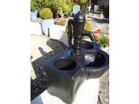 BLACK WATER FOUNTAIN USED AS A PLANT POT AS SEEN ONLY £15 FOR QUICK SALE