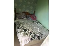 Double bed with wooden headboard good quality mattress