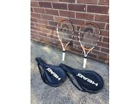 2 x tennis and 2 x badminton racquets with covers