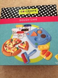 Play dough sets dough cafe and ice cream parlour plus loads of play dough equipment.