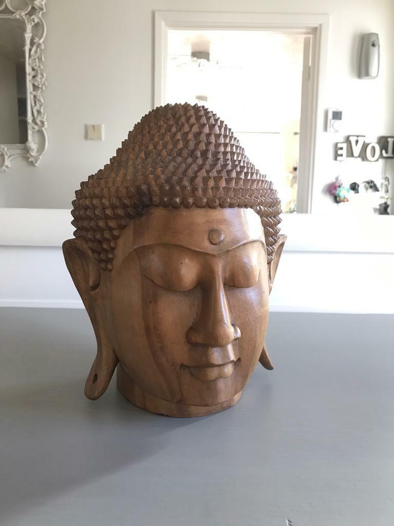 solid wooden buddha heads