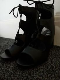 Size 6 Black pair of heels for sale