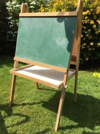 Easel for artwork includes a chalk board and whiteboard with wooden frame