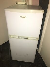Small fridge with freezer on top