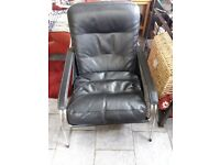 Black leather and chrome armchair as new was £995 new