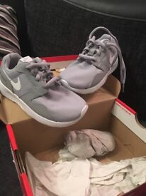 Grey Nike infant trainers