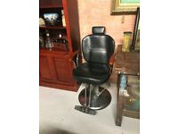 Offer sent to buyers Barbers Chair Fully Adjustable Black leatherette with wooden arms.