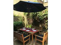 Teak table chairs and cushions