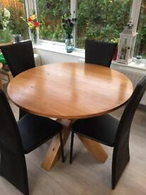 Solid Oak round table , Comes with 4 black chairs ,