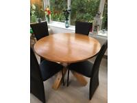 Solid Oak Next round table & 4 Chairs..