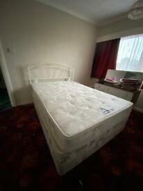 Double divan bed with mattress and white metal headboard