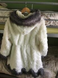 White furry coat