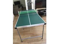 Mini table tennis for sale. 154 cm x 77 cm. Foldable table. In excellent condition with net.
