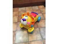 Fisher price lion ride on / walker great condition