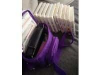 Nintendo DSi XL with games bundle, carry bag and case.