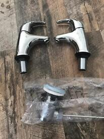 Brand new basin taps with waste