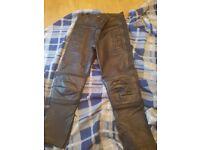 Leather biker pants.