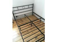 Black metal double bed frame