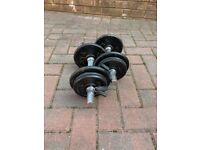 Two metal dumbbells with 16kg of weight plates included
