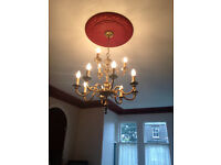 A PAIR OF VICTORIAN BRASS CHANDELIERS