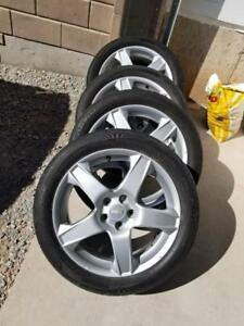 CHEVY SONIC  FACTORY OEM 17 INCH WHEELS WITH HIGH PERFORMANCE HANKOOK OPTIMO  205 / 50 / 17 ALL SEASON TIRES