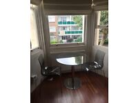 John Lewis glass round dining table + 2 John Lewis gel chairs color clear