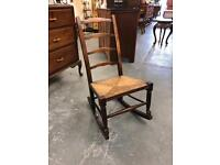Beautiful ladder back wicker seat antique rocking chair