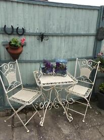 Gardens table two chairs