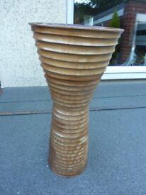 Wooden vase ornament.