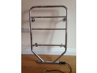 Electric heated chrome towel rail/radiator