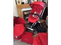 In really good condition. Includes 12 items. Nearly new carrycot in box, footmuff, blankets etc