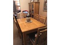 Extending dining table and chairs and matching display cabinet