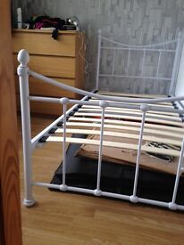 Two white metal single beds