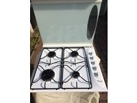 White Whirlpool Gas Hob, with drop down cover.